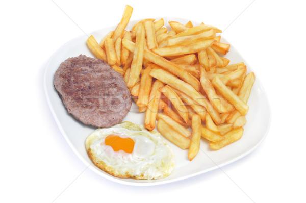 Kombináció tükörtojás hamburger sültkrumpli közelkép háttér Stock fotó © nito