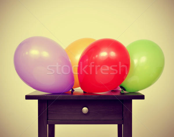 balloons of different colors on a table, with a retro effect Stock photo © nito