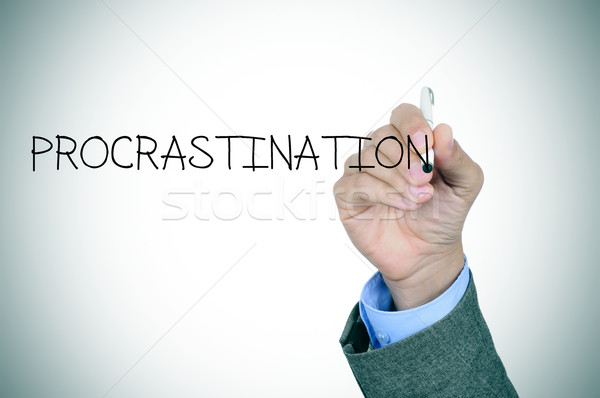 man writing the word procrastination Stock photo © nito