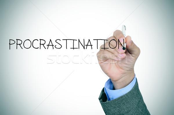 Homem escrita palavra procrastinação mão Foto stock © nito