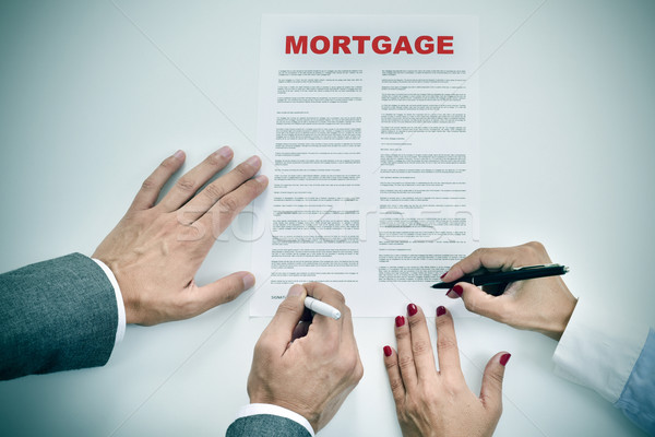 man and woman signing a mortgage loan contract Stock photo © nito