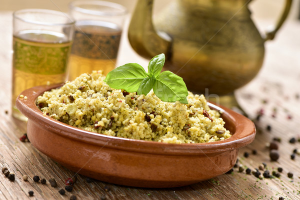 couscous with vegetables and tea on a rustic wooden table Stock photo © nito
