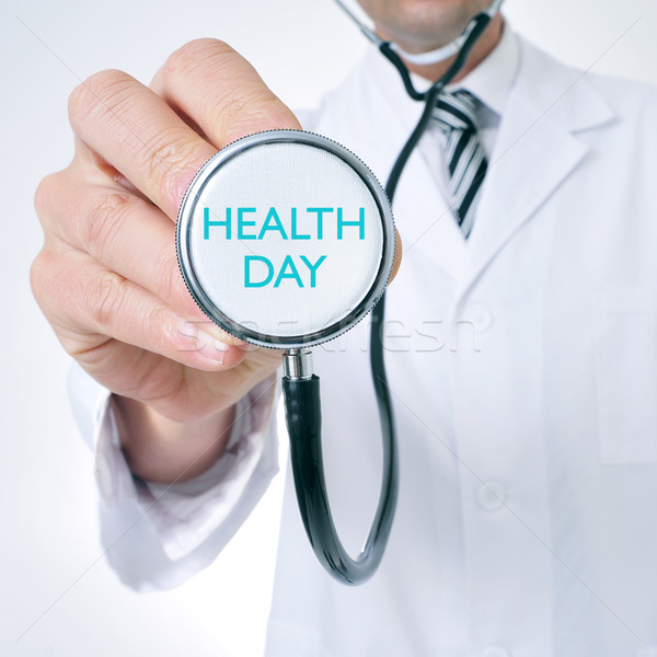 doctor shows a stethoscope with the text health day Stock photo © nito