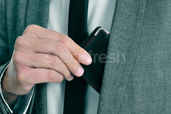 man in suit taking out his wallet Stock photo © nito