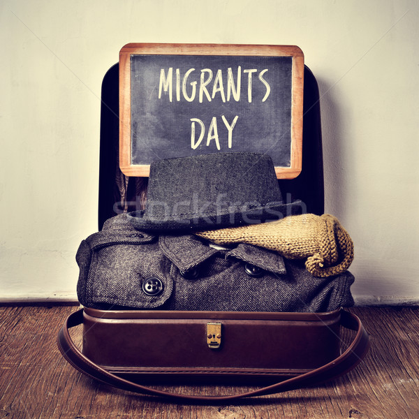 old suitcase with some clothing and chalkboard with text migrant Stock photo © nito