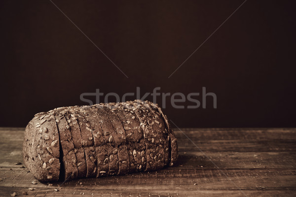 sliced rye bread on a wooden surface, sepia toned Stock photo © nito