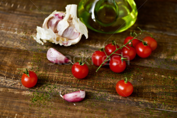 olive oil, cherry tomatoes and garlic on a wooden table Stock photo © nito