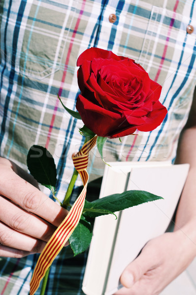 man with a rose with the Catalan flag and a book Stock photo © nito