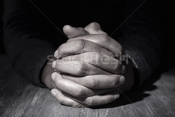 man with his hands clasped Stock photo © nito