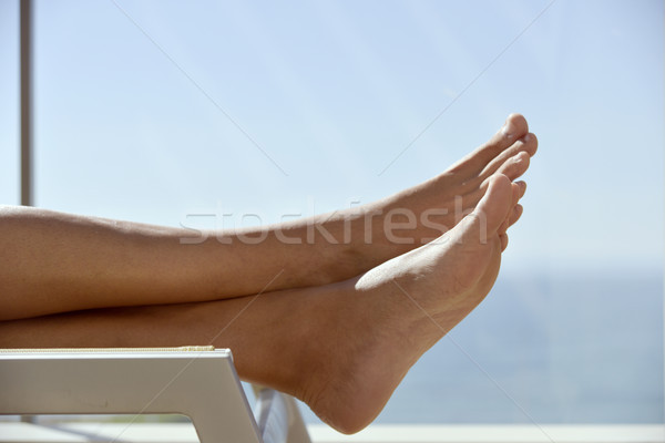 young man relaxing in a sunlounger Stock photo © nito