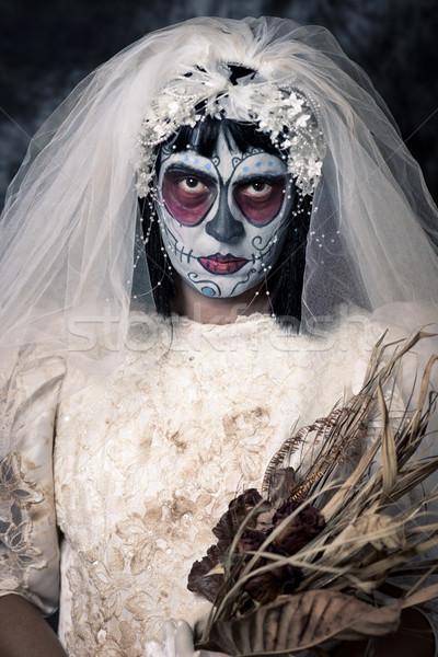 Stock photo: bride with a mexican calaveras makeup