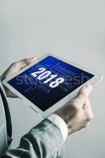 man and number 2018, as the new year, in a tablet Stock photo © nito