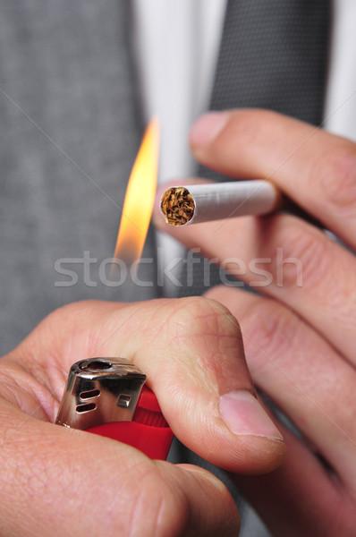 Sigara içme adam takım elbise aydınlatma sigara Stok fotoğraf © nito