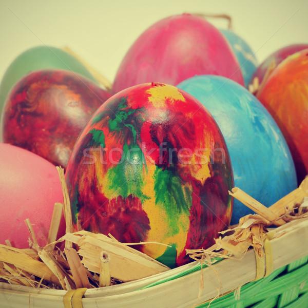 Stock fotó: Húsvéti · tojások · különböző · színek · kosár · szalmaszál · retro