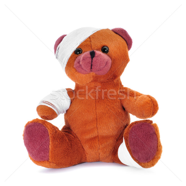 teddy bear with bandages in its head, arm and leg Stock photo © nito