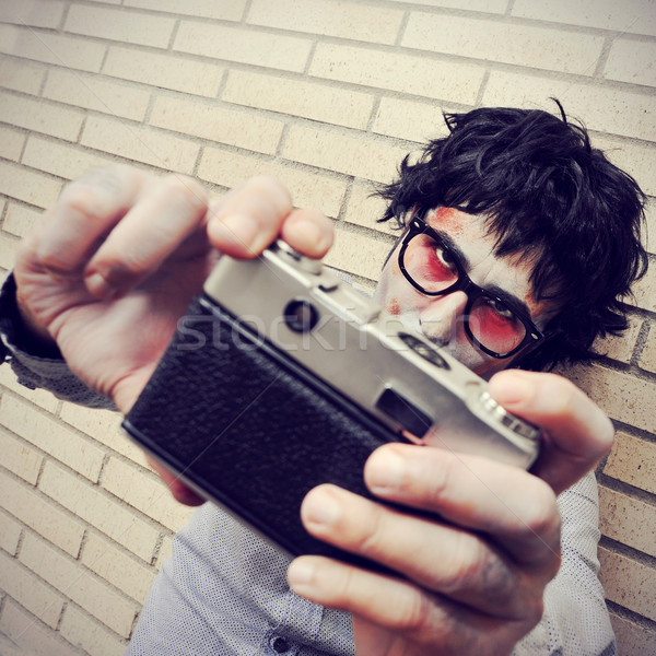 Stock photo: hipster zombie taking a selfie, with a retro effect