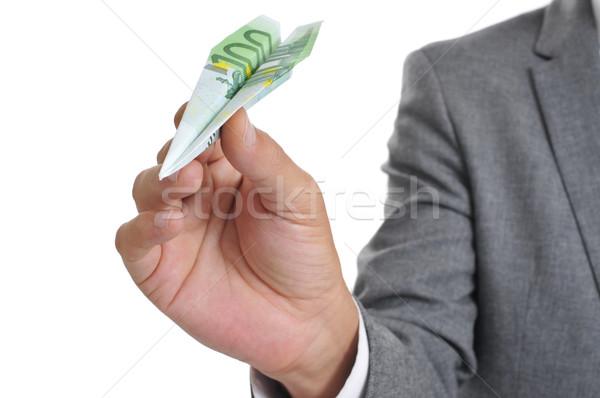 бизнесмен бумаги плоскости 100 евро банкнота Сток-фото © nito
