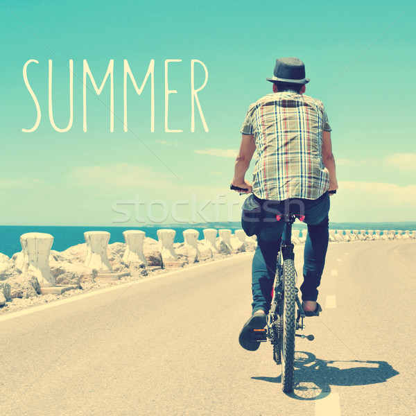 young man riding a bike and text summer, with a filter effect Stock photo © nito