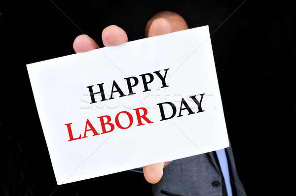 man showing a signboard with the text happy labor day Stock photo © nito