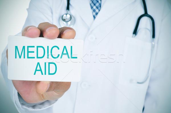 Médecin texte médicaux aide jeunes Photo stock © nito