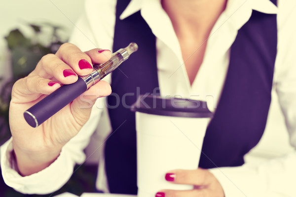 young woman vaping from an electronic cigarette Stock photo © nito