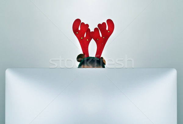 businessman with a reindeer antlers headband in his office Stock photo © nito