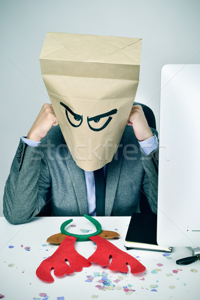 man in his office with a paper bag in his head in christmas Stock photo © nito