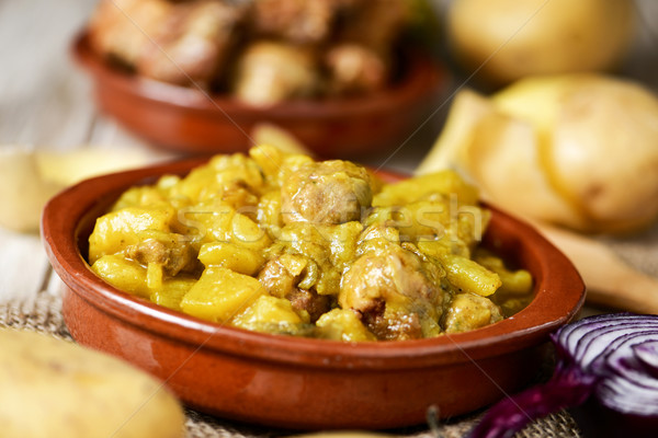spanish guiso de patatas con albondigas, a stew with potatotes a Stock photo © nito