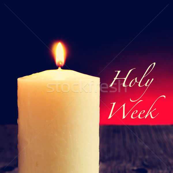 a lit candle and the text holy week Stock photo © nito