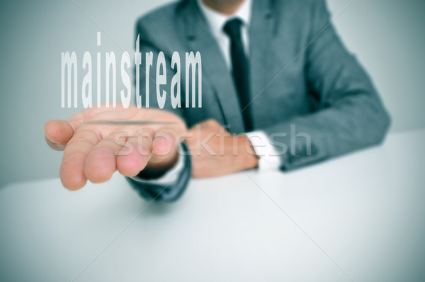 Férfi visel öltöny ül asztal tart Stock fotó © nito
