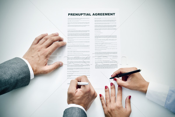 young man an woman signing a prenuptial agreement Stock photo © nito