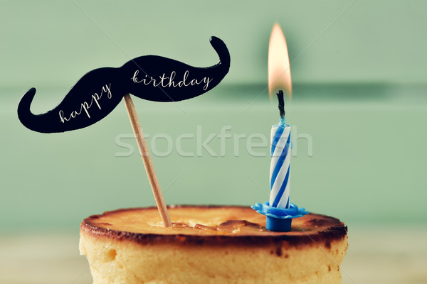 cake, lit candle and text happy birthday Stock photo © nito