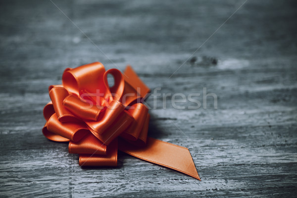 Stock photo: orange satin gift ribbon bow
