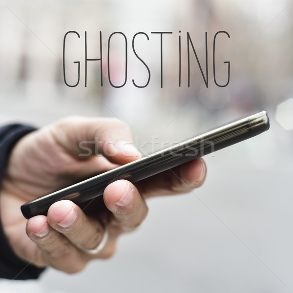 man with smartphone and text ghosting Stock photo © nito