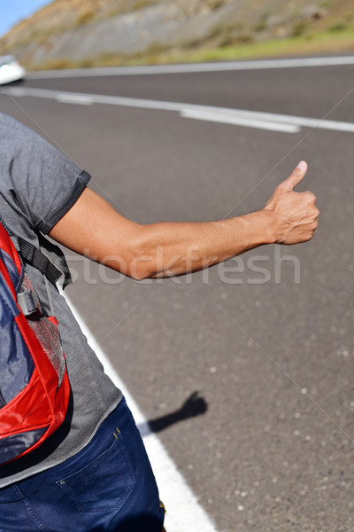 young backpacker man hitchhiking Stock photo © nito