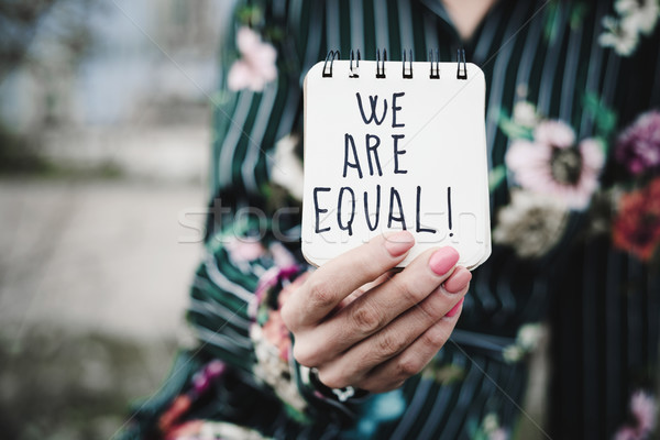 woman shows notepad with the text we are equal Stock photo © nito