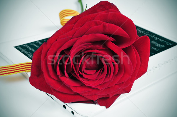 red rose and e-book, for Saint Georges Day in Catalonia, Spain Stock photo © nito