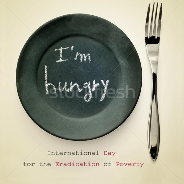 Uluslararası gün yoksulluk çatal plaka boyalı Stok fotoğraf © nito
