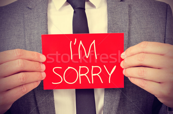 man with signboard with the text I am sorry Stock photo © nito