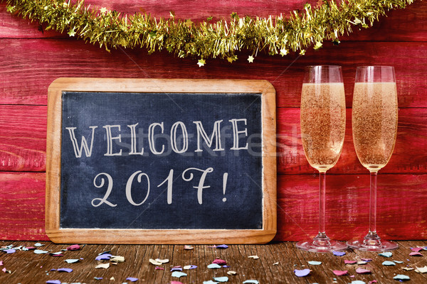 confetti, champagne and text welcome 2017 Stock photo © nito