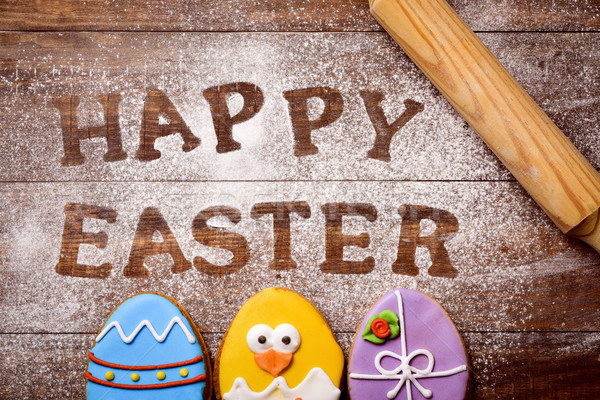 text happy easter and cookies decorated as easter eggs Stock photo © nito
