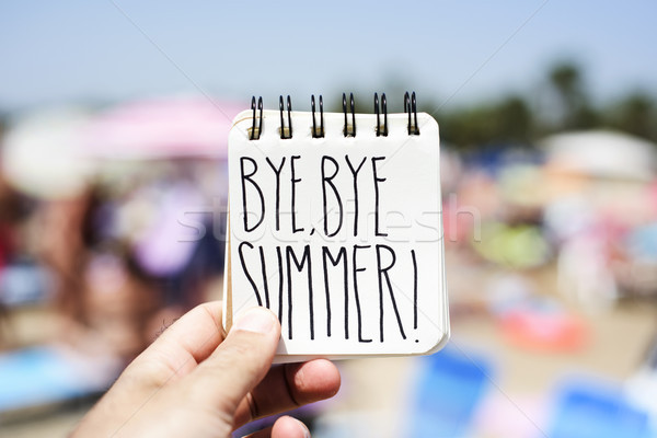 man with a note with the text bye bye summer Stock photo © nito