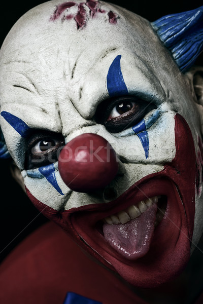 scary evil clown taking out his tongue Stock photo © nito