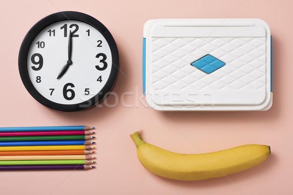 pencil crayons, clock, banana and lunch box Stock photo © nito