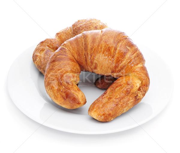 Croissantok tányér fehér eszik desszert édes Stock fotó © nito