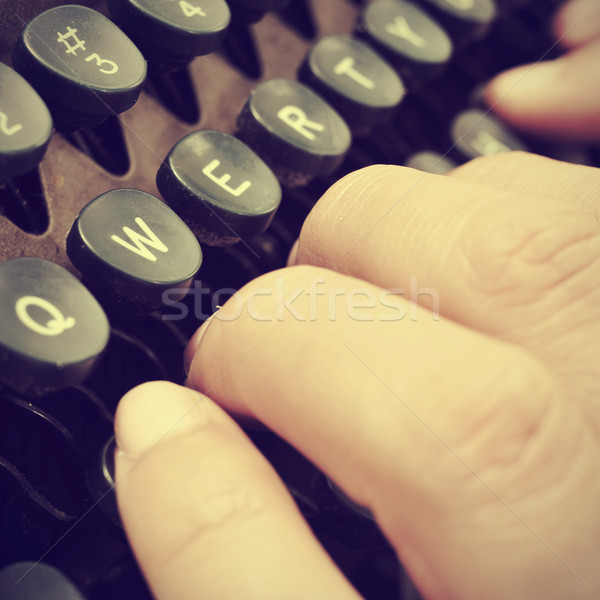 typing on an old typewriter, with a retro effect Stock photo © nito