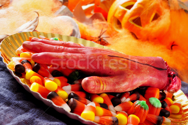 amputated hand and Halloween candies Stock photo © nito