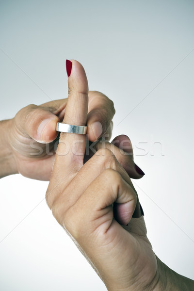 man putting on or putting off a ring from the finger of a woman Stock photo © nito