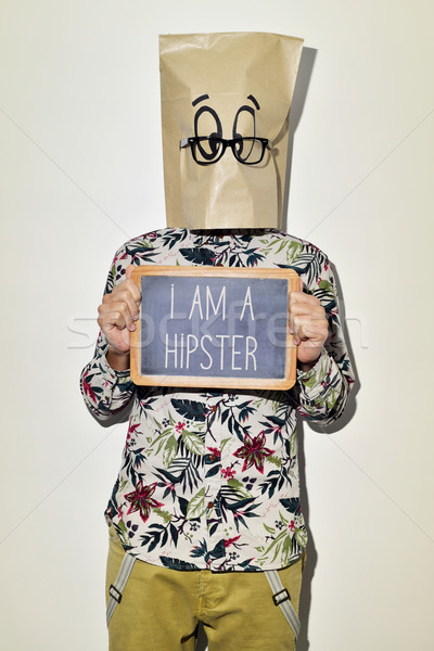 Stock photo: man with chalkboard with text I am a hipster