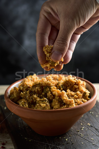 man eating couscous with his fingers Stock photo © nito